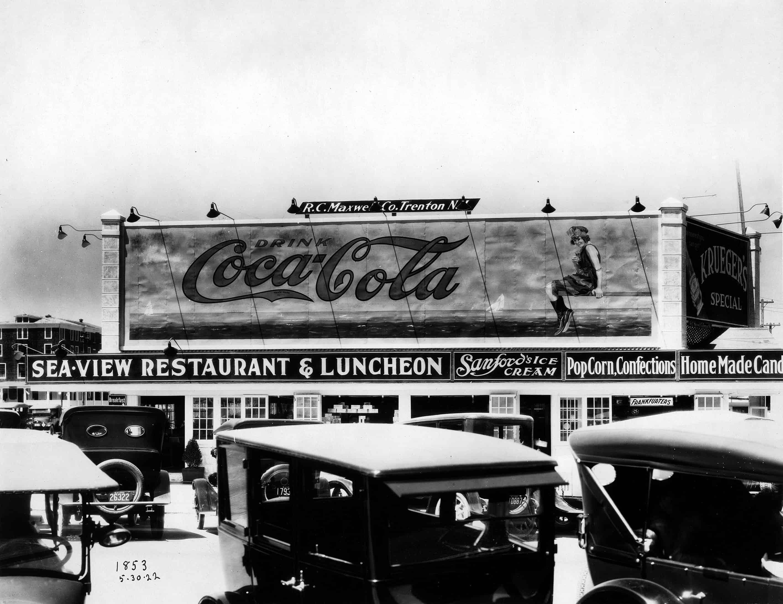 origem e evolução do marketing: outdoor da coca-cola em 1922