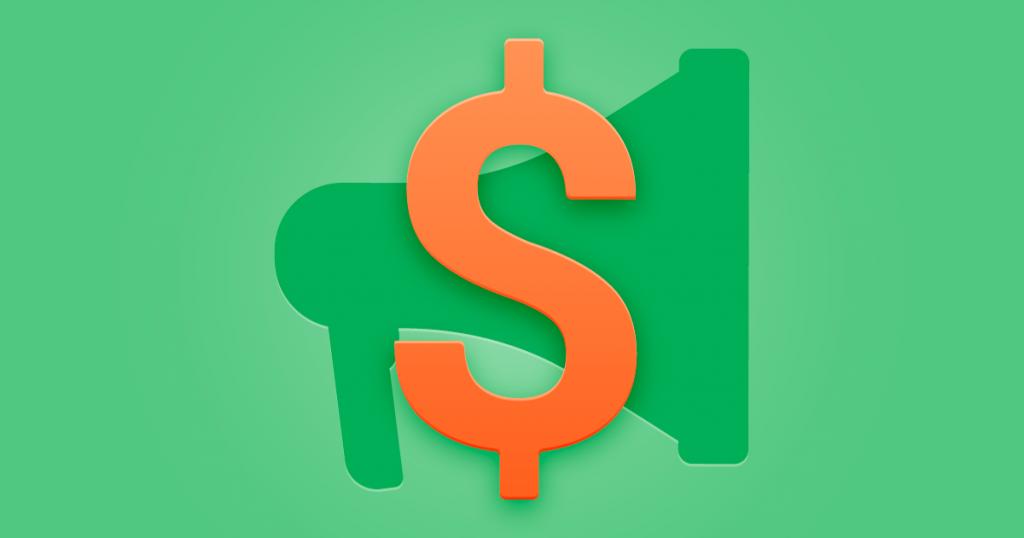presupuesto de marketing - dos billetes con un dibujo de un megáfono